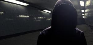 Hoodie gangster in subway (face in shadow)