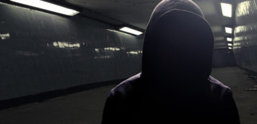 Hoodie gangster in subway (face in shadow)
