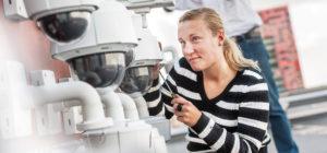 Woman fixing camera.