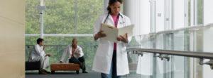 Medical professionals in hospital corridor.