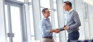 Two business people shake hands.