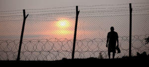 high_fence_man_sunset_1508_1540x700