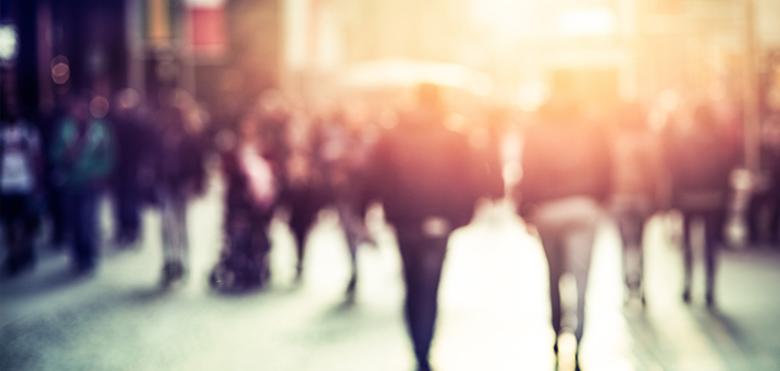 People walking outside, blurry