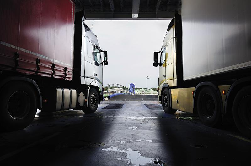 Trucks leaving ferry