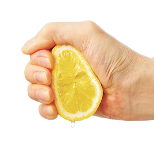 Hand squeezing lemon