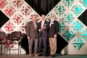 Axis Communications accepting the Innovative Product Award at GSX 2018 for its AXIS Device Manager
