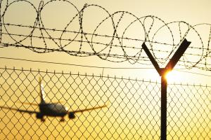 airplane_fence_barbed_wire_yellow_1700w