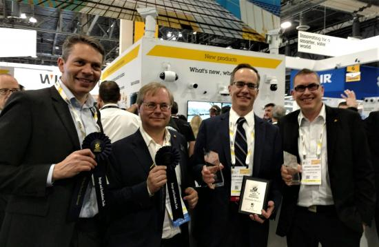 (From left to right) Axis Communications' Fredrik Nilsson, Martin Gren, James Marcella and Andres Vigren accepted SIA New Product Showcase awards at ISC West