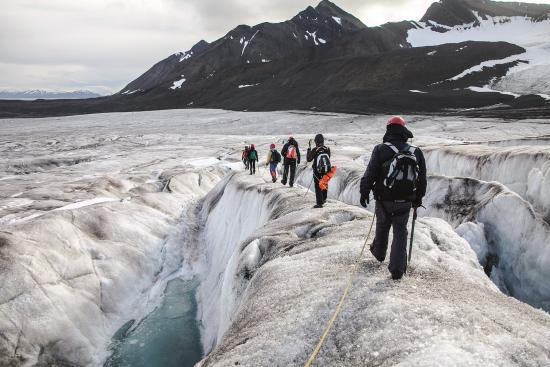 People walking on a glacier