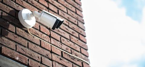 AXIS Q1765-LE Network Camera on a brick wall