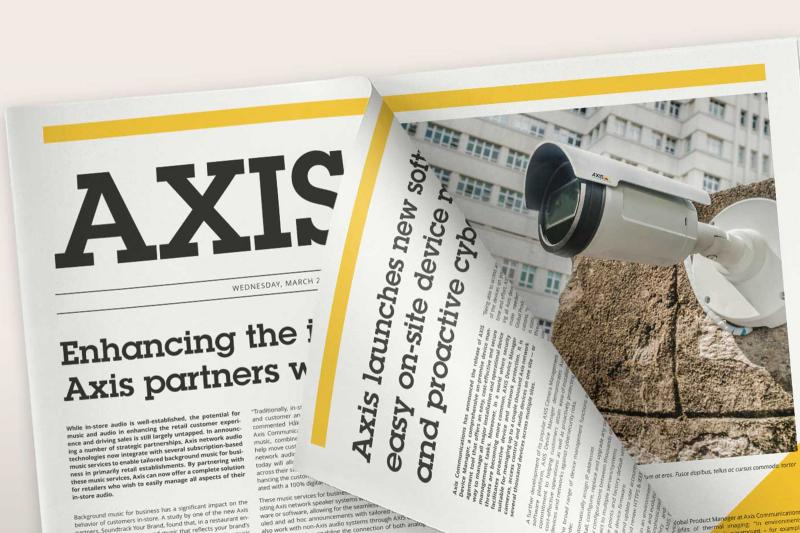 Axis newspaper with articles about cameras