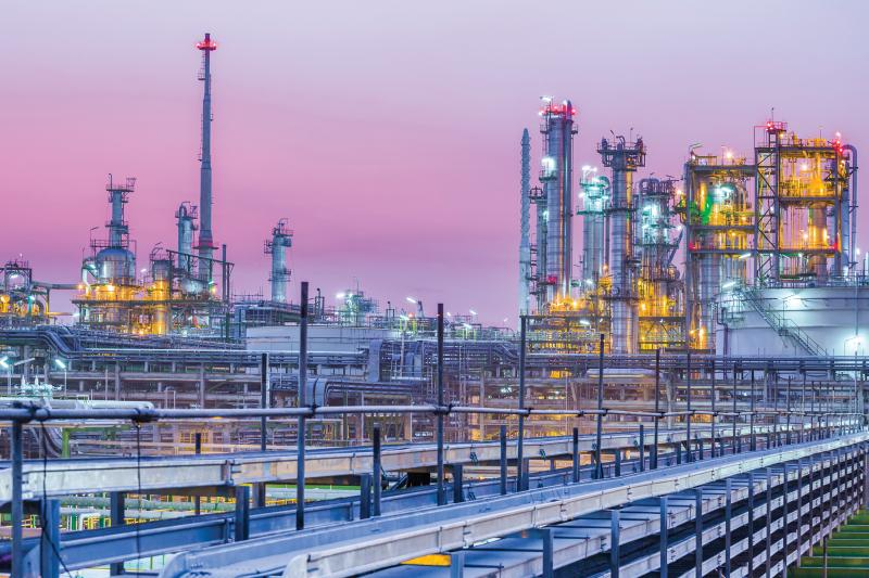 petrochemical plant in purple twilight