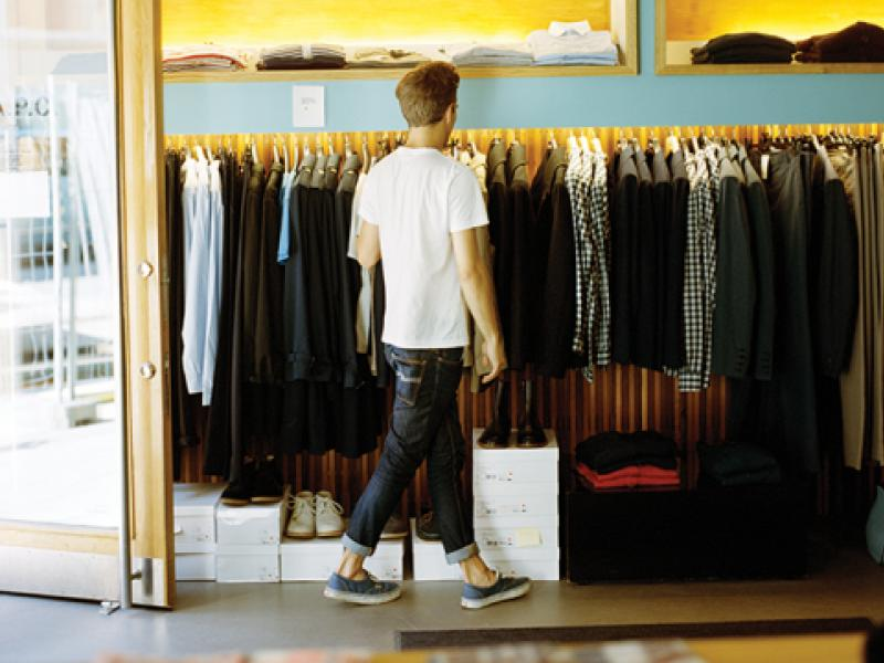 man shopping clothing rack