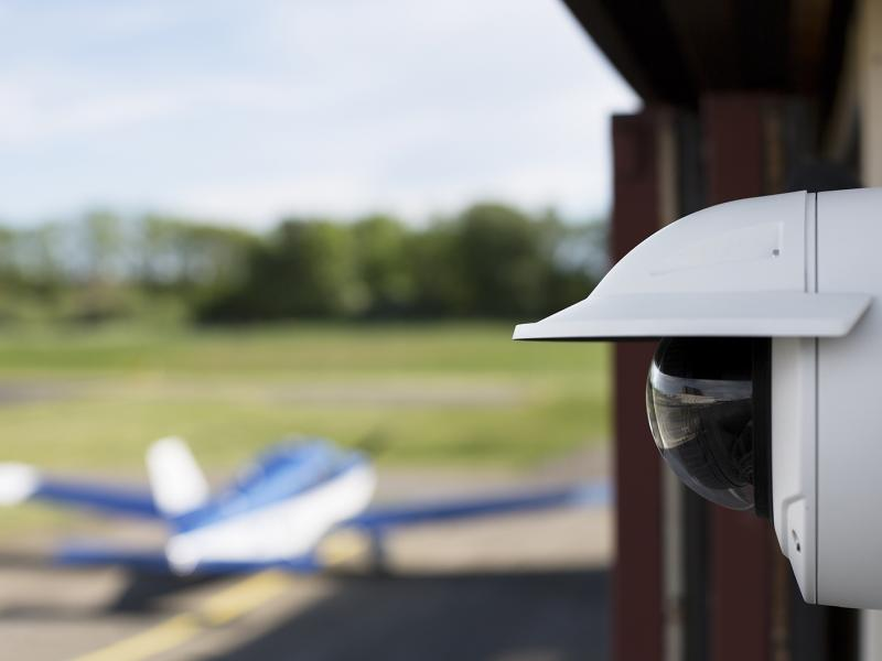 Axis IP camera viewed from a airplane outdoor hangar