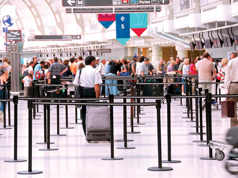 Passengers queues at check-in on airport