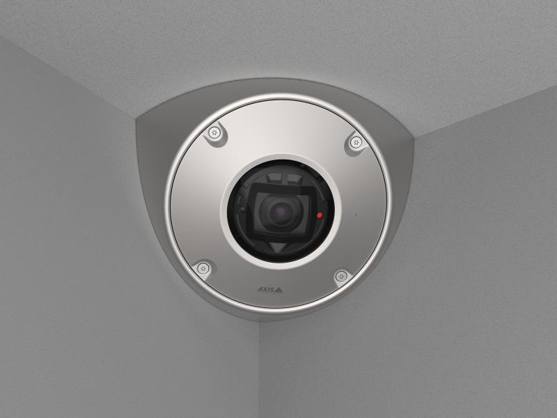 AXIS Q9216-SLV in stainless steel, mounted in a corner with gray walls