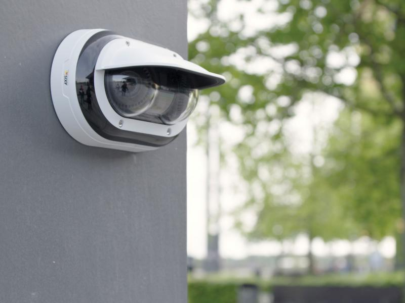 AXIS P3715-PLVE Network Camera mounted on wall outdoors