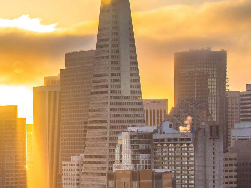 sunrise over buildings in san francisco