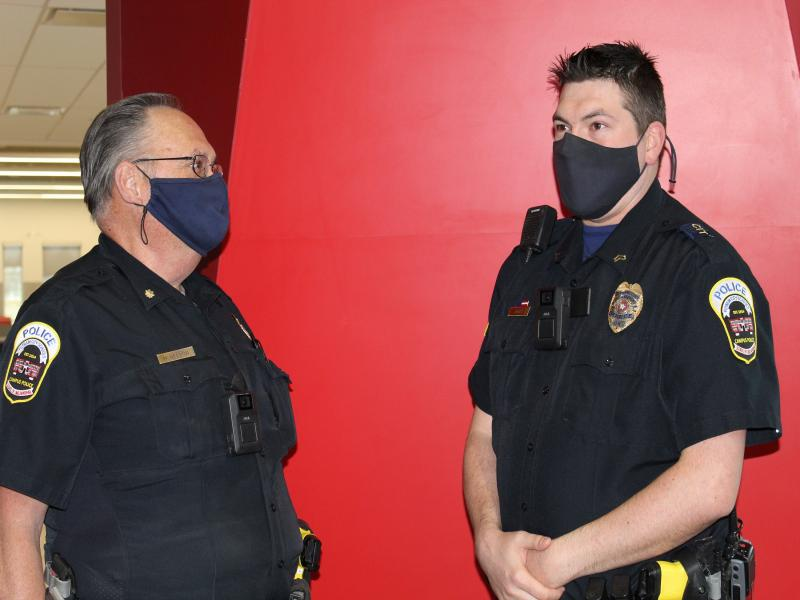 Two Putnam City Campus Police officers wear body worn cameras