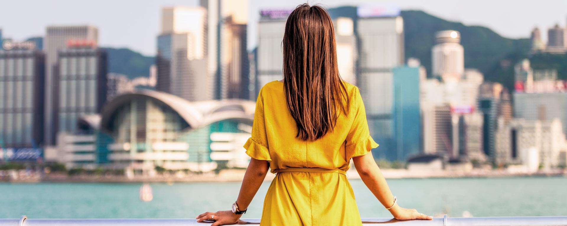 Woman looking out over a city