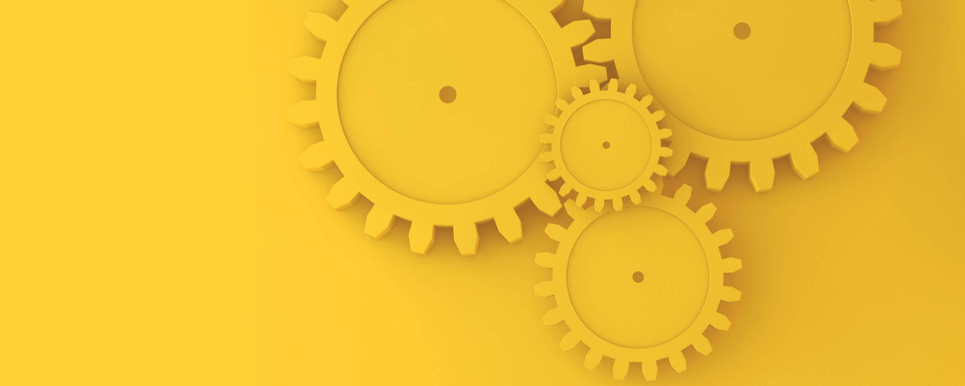 wheels in different sizes in a yellow color on a yellow background