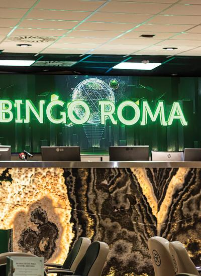 Bingo Roma room from the inside with big sign and seats in front.
