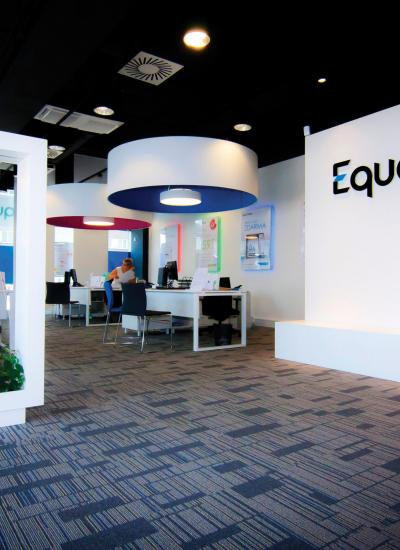 Inside of Equa bank, white walls and colorful lamps.
