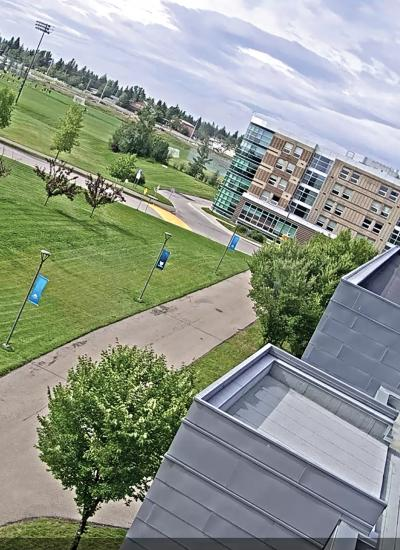 Exterior of campus viewed above from tilted angle, green grass outside.