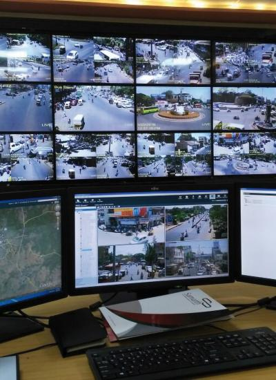 Monitors showing video footage from security cameras