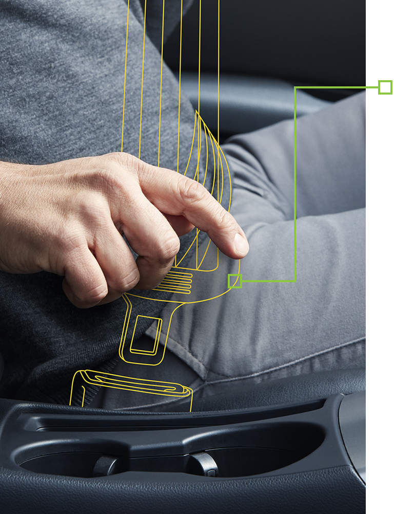 Male hand fastening a seat belt in the car