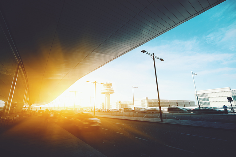 airport_terminal_entrance_sunlight_traffic