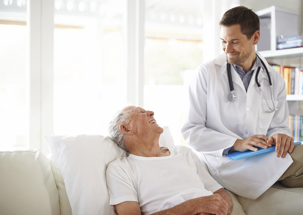 Elderly man talking to doctor