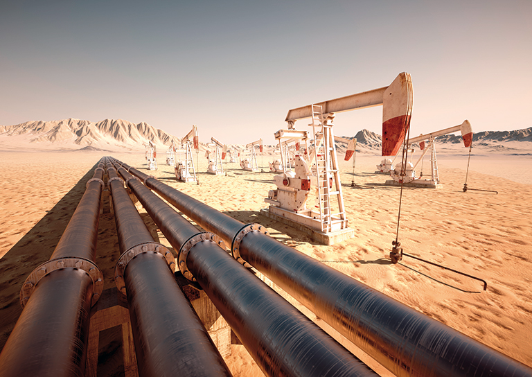Pipelines and oil pump jacks in the desert