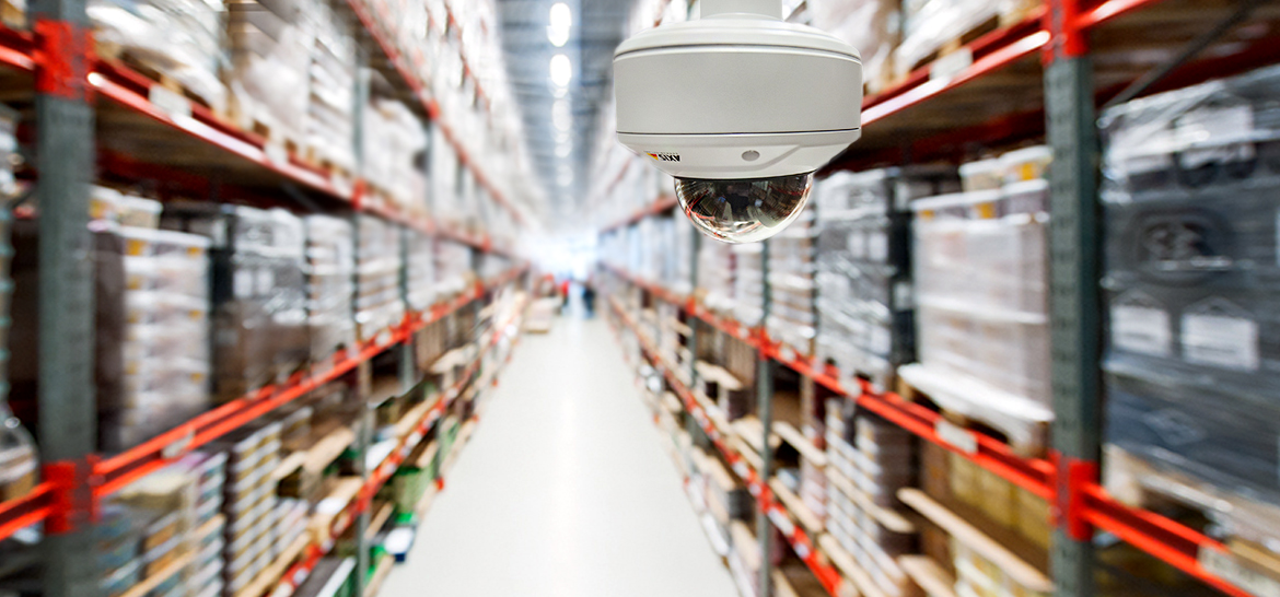 Camera in warehouse aisle