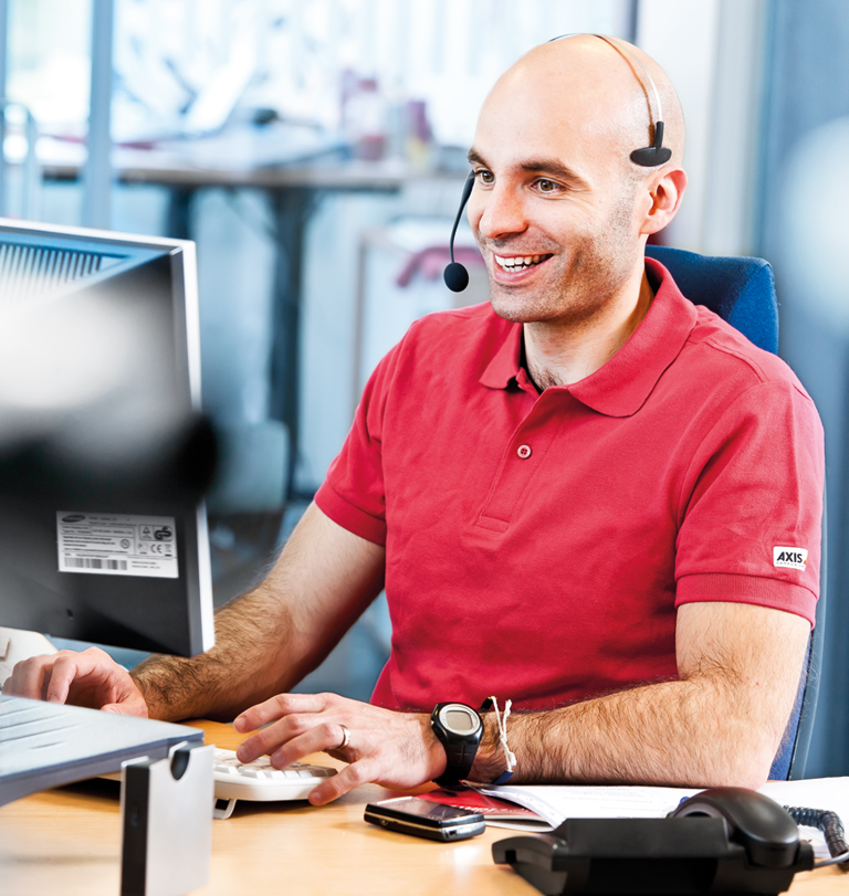 Support - man with headset at desk